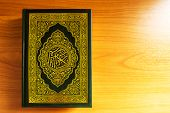 foto of quran  - The quran on the wooden table background - JPG