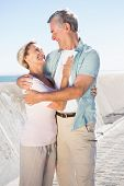 Happy senior couple embracing on the pier on a sunny day