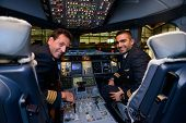 HONG KONG, CHINA - MAY 16, 2014: pilots in Emirates Airbus A380 aircraft after landing on May 16, 2014. Emirates is the largest airline in the Middle East