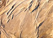 Sand Surface With The Relief Formed By Water Currents