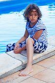 unhappy girls near the pool