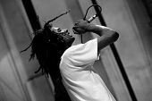 stock photo of rasta  - rock singer with rasta hair performing live on stage OUT LOUD