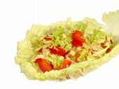 Salad On Lettuce Leaf In The Shape Of A Spoon Isolated On White Background