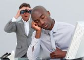 Ethnic Businessman Annoyed By A Man Looking Through Binoculars