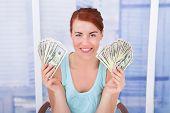 Woman Showing Dollar Bills At Home