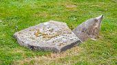 Very Old Broken Gravestone In The Cemetery