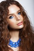 Portrait Of Young Woman With Trendy Vivid Makeup