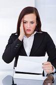 Shocked Businesswoman Reading Document