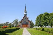 stock photo of deportation  - The Memorial Church of Grand Pre is located in the Annapolis Valley of Nova Scotia and is in the Grand Pre National Historic Site which is a park that commemorates the deportation of the Acadians between 1755 and 1763 - JPG