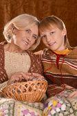 Senior woman knitting with grandson