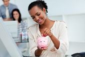 Positive Businesswoman Saving Money In A Piggy-bank