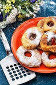 sweet donuts with powdered sugar