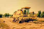 Yellow Agricultural Harvester Machine