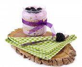 Healthy breakfast - yogurt with  blackberries and muesli served in glass jar, on wooden board, isola