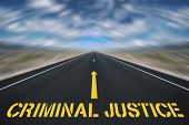 stock photo of criminology  - sign criminal justice placed on black road - JPG