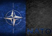 Old Rusty Metal Sign With A Nato Flag