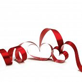 Heart shaped red ribbon isolated on white background