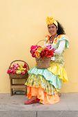 HAVANA, CUBA - JANUARY 8, 2015 : Young latin woman wearing a traditional dress in Old Havana