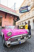 HAVANA, CUBA - JANUARY 8, 2015 : Old american car next to the famous Floridita restaurant in Old Havana