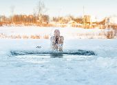Traditional Russian  winter recreation  swimming in the ice-hole