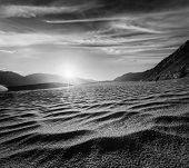 Sand dunes in Himalayas on sunrise. Hunder, Nubra valley, Ladakh, India. Black and white version