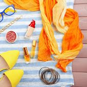 Fashionable female clothing and accessories, on color wooden background