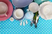Different tableware on tablecloth