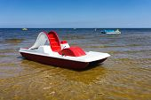 Red Dinghy On The Golden Beach Of The Baltic Sea