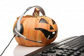 jack o lantern customer serivice with headset and keyboard