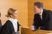 image of court room  - Lawyer speaking with the judge in the court room - JPG