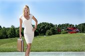 Businesswoman in Front of a Helicopter (1)