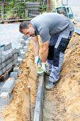 Worker Puts Border Stones.