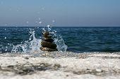 Wave Splash And A Zen Symbol