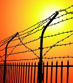 picture of stockade  - vector silhouette barbed wire fence at sunset - JPG