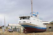 Former fishing boat lays onshore Aralsk, Kazakhstan.