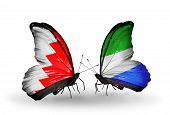 Two Butterflies With Flags On Wings As Symbol Of Relations Bahrain And Sierra Leone