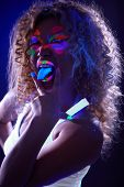 Amusing visage model posing in UV light