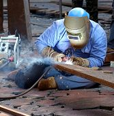 Welder Using The Shielded Metal Arc Process