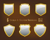 Collection of golden and silver shields. Set of six simple glossy silver shields with golden frames vector illustration.
