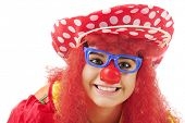 Closeup image of a teenage clown.  On a white background.