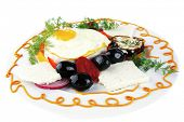 fresh fried egg served on white plate with vegetables
