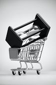 stock photo of grocery cart  - Hourglass in grocery cart on a light background - JPG