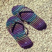 Flip-flops On Stony Beach