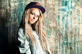 stock photo of dreadlock  - Modern teenage girl with blonde dreadlocks - JPG