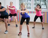 picture of squatting  - Gym people doing squats during fitness classes - JPG