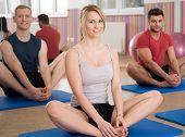 stock photo of yoga instructor  - Yoga instructor showing exercise during yoga classes - JPG
