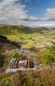 image of derelict  - Looking down the welsh valley of Cwm Penmachno derelict incline drum house disused slate quarry in foreground - JPG