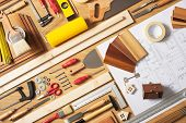 picture of draft  - Do it yourself home improvement and renovation concept work table top view with work tools and draft project top view - JPG