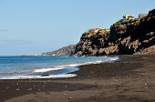 pic of atlantic ocean beach  - The oceanfront city of Sao Filipe sits atop a cliff plateau overlooking a black sand beach and the Atlantic Ocean below - JPG