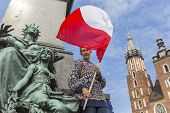 pic of polonia  - Woman with the Polish flag in the main square of Krakow - JPG